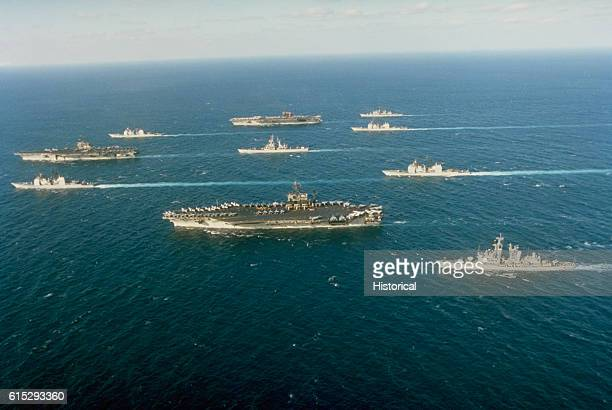 Ten ships of Task Force 155 gather during Operation Desert Storm Leading the formation at left is the aircraft carrier USS Saratoga flanked by the...