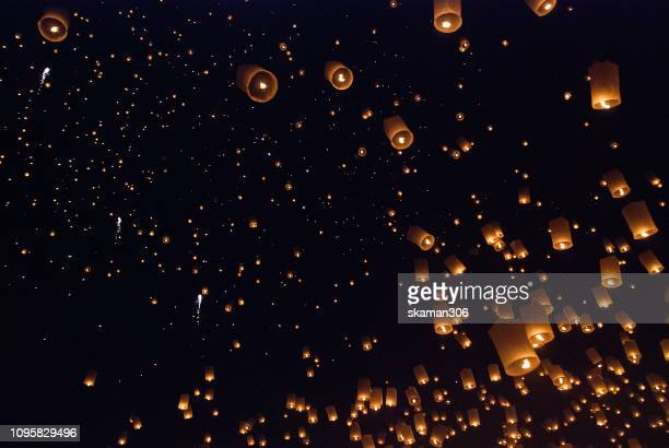ten thousand asian lanterns light fly to the sky at chiangmai thailand - lantern festival stock pictures, royalty-free photos & images