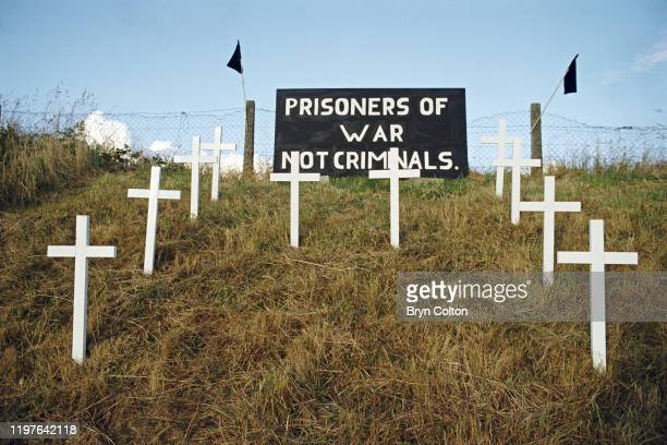 Ten white crosses, a memorial to the ten Irish Republican Army fighters during their 1980 hunger strike on a roadside outside the village of...