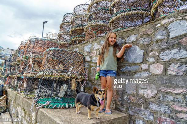Ten year old girl and lobster pots