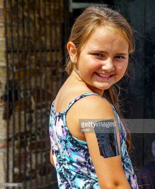 ten year old girl temporary tattoo - temporary stock pictures, royalty-free photos & images
