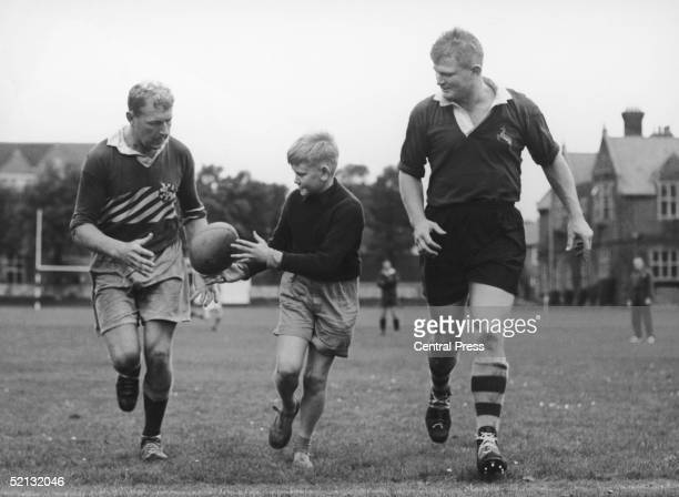 Ten year old Londoner Charles Sabourin joining Wallabies MacHughes left and Tony Millar while they train in the grounds of Eastbourne College 28th...