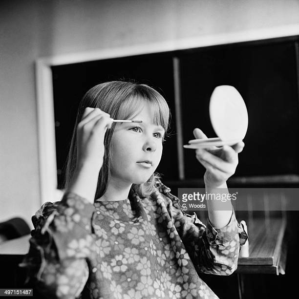 Ten year-old Caroline Bastin putting on mascara at her home in Waterlooville, Hampshire, 7th June 1968.