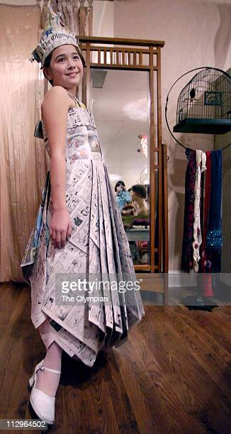 Ten yearold Hanae Livingston likes to see herself in print literally as she fashions her Sunday comics dress made by her father Ed while stopping at...