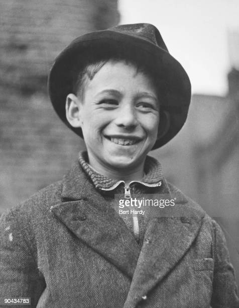 Ten yearold Shamus O'Brien mascot of the 'Dead End Kids' a gang of teenage boys from the East End of London who work as unofficial fire fighters...