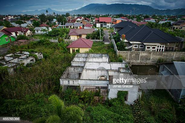Ten years after the 2004 tsunami disaster the bare bones of several ruined homes still stand The tsunami of December 2004 was as deadly as the atomic...
