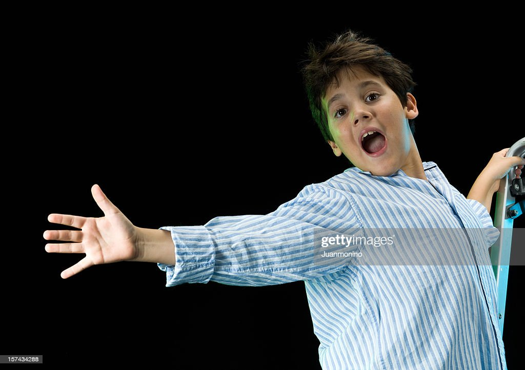 Ten years old singing child : Stock Photo