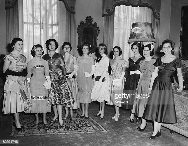 Ten young debutantes from Italy leave the Italian Embassy in London for a presentation party at Buckingham Palace, 18th March 1958. From left to...