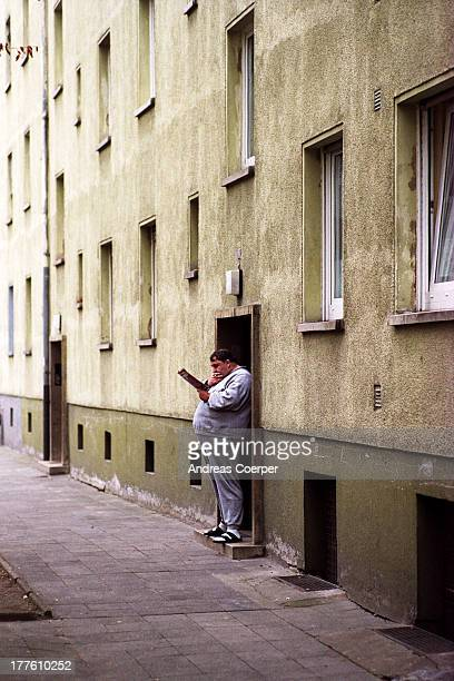 CONTENT] A tenant of an appartment flat building stands on his doorstep studying a leaflet