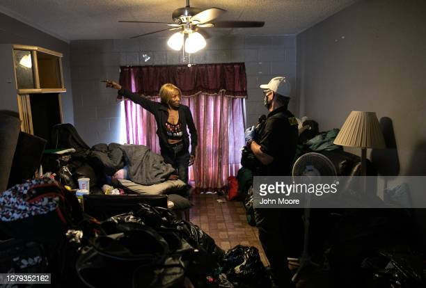 Tenant speaks with Maricopa County constable Lenny McCloskey as he serves her an eviction order on October 2, 2020 in Phoenix, Arizona. Thousands of...