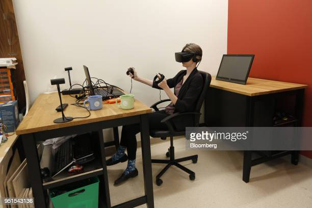 A tenant uses a virtual reality headset to manipulate a digital model at the Bayview Yards innovation center in Ottawa Ontario Canada on Wednesday...