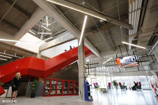Tenants walk through the lobby at the Bayview Yards innovation center in Ottawa Ontario Canada on Wednesday April 25 2018 Bayview Yards is a...