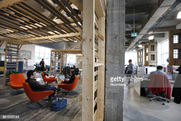 Tenants work at the Bayview Yards innovation center in Ottawa Ontario Canada on Wednesday April 25 2018 Bayview Yards is a federallyincorporated...