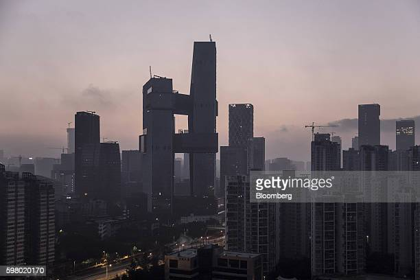 Tencent Holdings Ltd's new headquarters center left stand under construction in Shenzhen China on Monday Aug 22 2016 The new headquarters for Tencent...