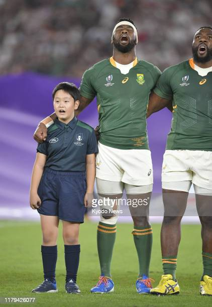 Tendai Mtawarira and captain Siya Kolisi both of South Africa and a child mascot line up before a Rugby World Cup final against England on Nov 2 in...