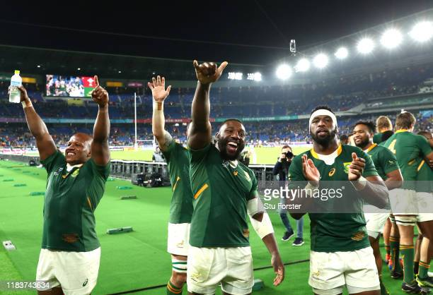 Tendai Mtawarira of South Africa and team mates celebrate during the Rugby World Cup 2019 Semi-Final match between Wales and South Africa at...