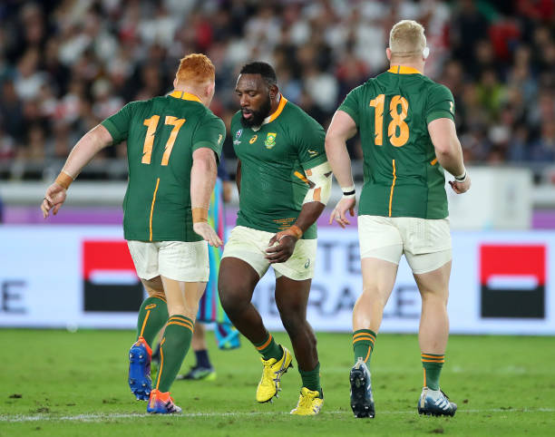YOKOHAMA, JAPAN - NOVEMBER 02: Tendai Mtawarira of South Africa leaves the pitch past Steven Kitshoff (L) and Vincent Koch of South Africa during the Rugby World Cup 2019 Final between England and South Africa at International Stadium Yokohama on November 02, 2019 in Yokohama, Kanagawa, Japan. (Photo by Cameron Spencer/Getty Images)