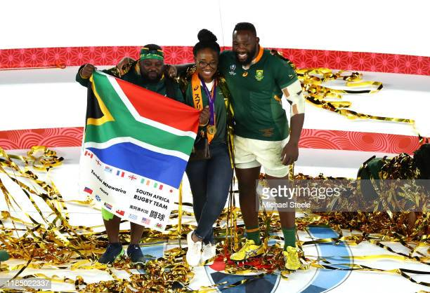 Tendai Mtawarira of South Africa poses for a photo with family as they celebrate their team's victory after the Rugby World Cup 2019 Final between...