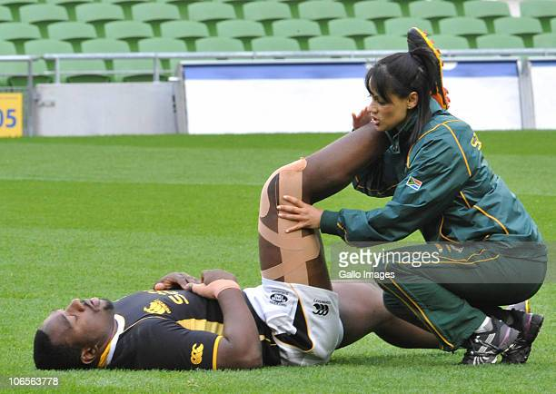Tendai Mtawarira of South Africa stretches with the help of physio Rene Naylor during a Springboks training session at Aviva Stadium on November 05...
