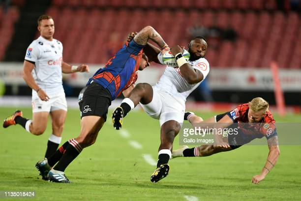 Tendai Mtawarira of the Cell C Sharks is tackled by Malcolm Marx and Tyrone Green of the Emirates Lions during the Super Rugby match between Emirates...