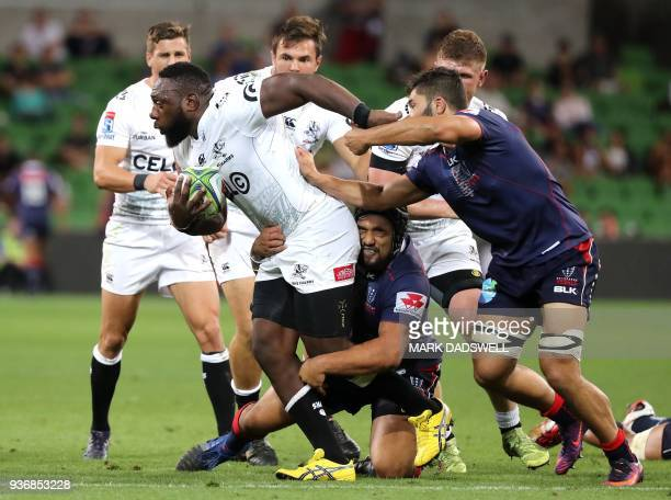 TOPSHOT Tendai Mtawarira of the Sharks breaks a tackle during the Super Rugby union match between the Melbourne Rebels of Australia and the Coastal...