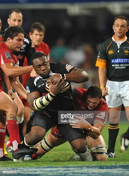 Tendai Mtawarira of the Sharks tackled by Scott Higginbotham of the Reds during the Super 14 match between Sharks and Reds from Absa Stadium on April...