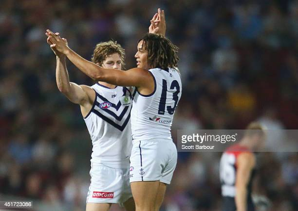Tendai Mzungu of the Dockers celebrates after kicking a goal during the round 16 AFL match between the Melbourne Demons and the Fremantle Dockers at...