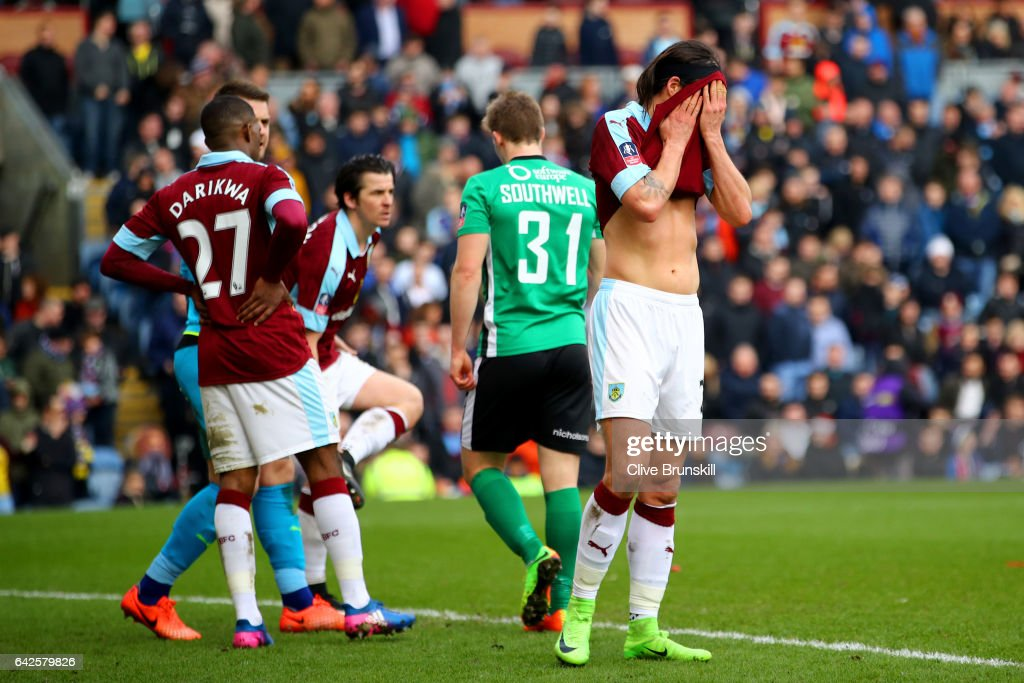 Tendayi Darikwa of Burnley (L) and George Boyd of Burnley (R) are dejected are Lincoln City score during The Emirates FA Cup Fifth Round match between Burnley and Lincoln City at Turf Moor on February 18, 2017 in Burnley, England.