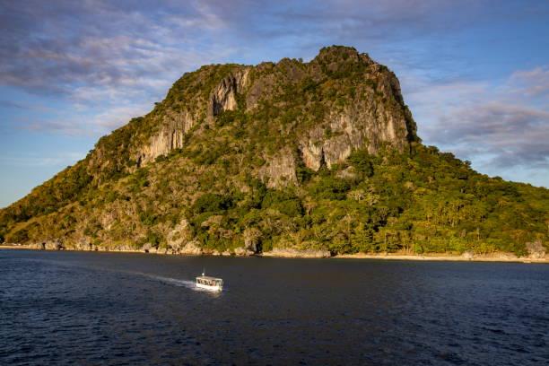 Tender boat of cruise ship MV Reef Endeavour (Captain Cook Cruises Fiji) and Sawa-i-Lau mountain
