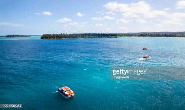tender boats returning to the cruise ship. from the isle of pines new caledonia - new caledonia stock photos and pictures