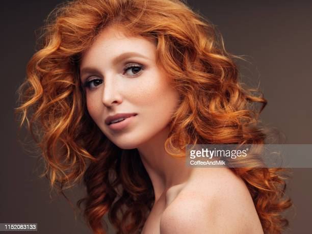 tender girl with fluffy red hair - permed hair stock pictures, royalty-free photos & images