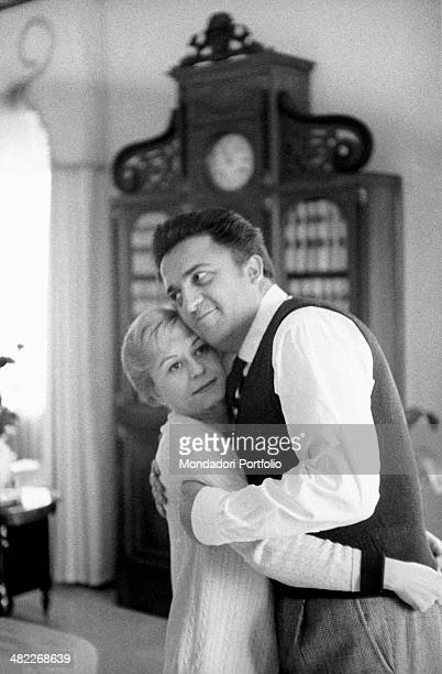 A tender hug between the famous Italian movie director Federico Fellini and Giulietta Masina in the sunny living room of their house in Rome Fellini...