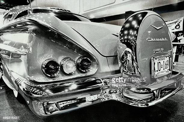 Tender Loving Care is shown in the detail of this specially chromed and customized rear end of a 1958 Chevrolet Impala Rearmounted spare tire and...