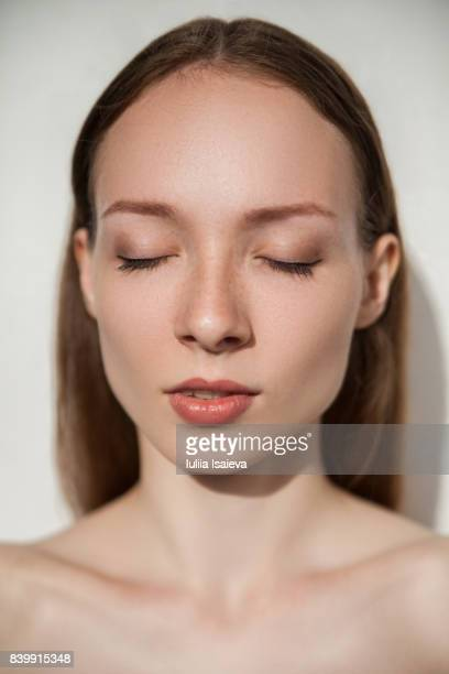Tender model with eyes closed