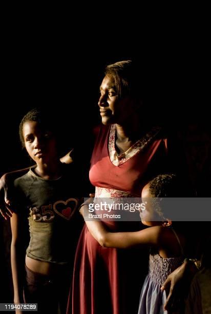 Tenderness between mother and children black family São Raimundo Quilombo Alcântara Maranhão Brazil