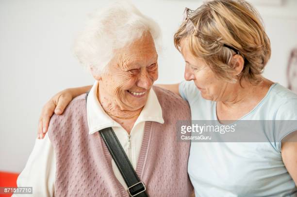 tenderness between senior mother and mature daughter - adult offspring stock pictures, royalty-free photos & images