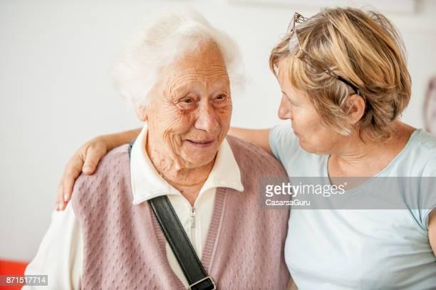 Tenderness Between Senior Mother And Mature Daughter