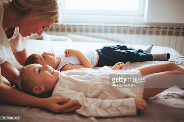 tenderness - family with two children stock photos and pictures