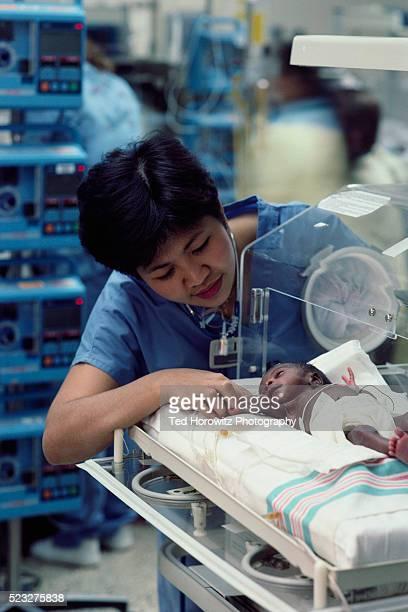 Tending to Premature Baby in Neonatal Intensive Care