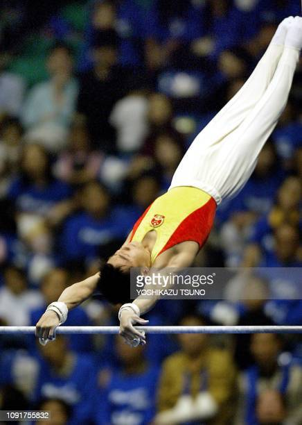 Teng Haibin of China performs on the horizontal bar during the men's apparatus finals for the 14th Asian Games in Busan, 05 October 2002. Teng won...