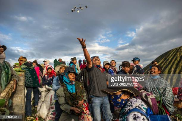 Tengger tribe people make their way to the summit of Mount Bromo volcano to make offerings in Probolinggo, East Java province on July 7 as part of...