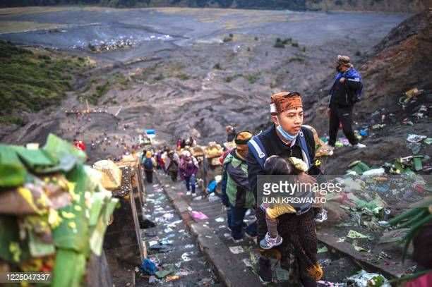 TOPSHOT Tengger tribe people make their way to the summit of Mount Bromo volcano to make offerings in Probolinggo East Java province on July 7 as...