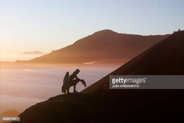 Tengger tribes people place vegetables as offerings at Mount Bromo during the annual Kasada ceremony in East Java on August 12 2014 The Kasada...