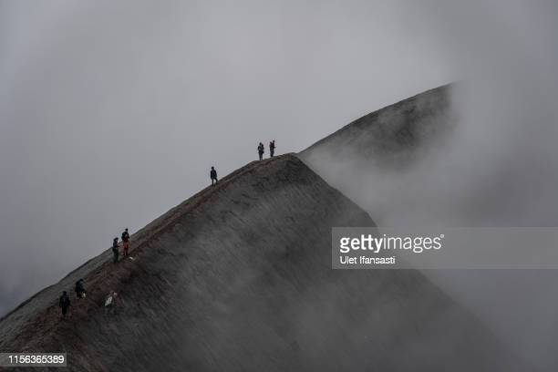 Tenggerese gather at crater of Mount Bromo during the Yadnya Kasada Festival on July 18 2019 in Probolinggo Java Indonesia Tenggerese people are a...