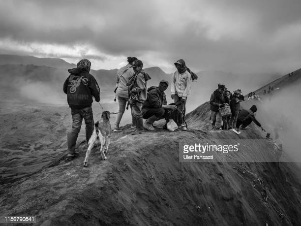 Tenggerese gather at crater of Mount Bromo during the Yadnya Kasada Festival on July 18 2019 in Probolinggo East Java Indonesia Tenggerese people are...
