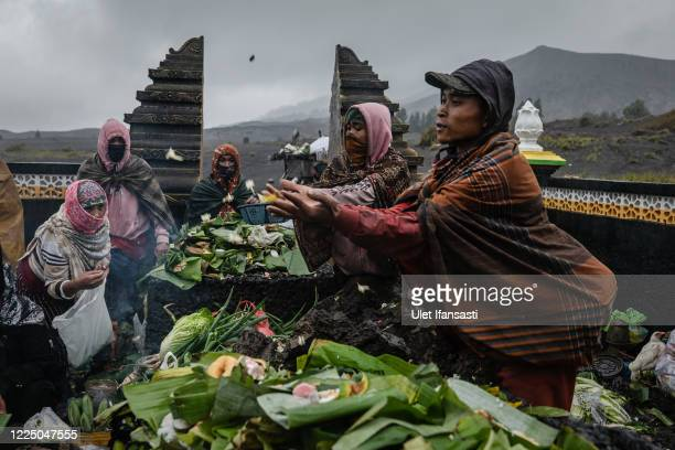 Tenggerese gather praying at a temple before going to mount Bromo during the Yadnya Kasada Festival at the crater of Mount Bromo amid the coronavirus...