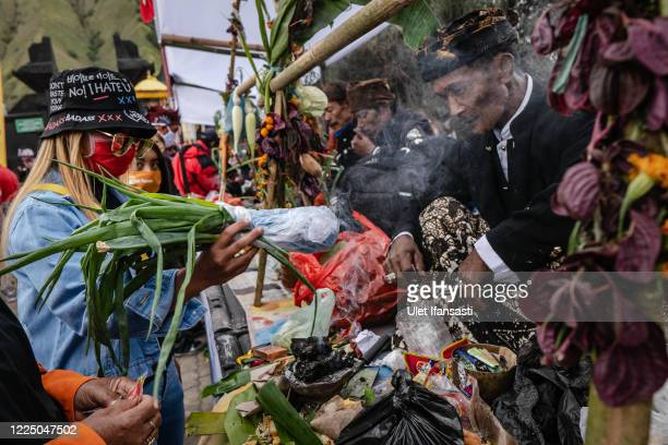 Tenggerese gather praying at Poten temple before going to Mount Bromo during the Yadnya Kasada Festival at the crater of Mount Bromo amid the...