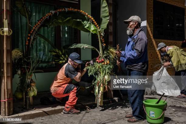 Tenggerese people making offerings of rice fruits vegetables flowers known as 'Ongkek' as they prepare for Yadnya Kasada Festival on July 17 2019 in...