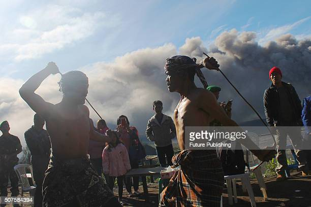 """Tenggerese performs traditional dance called """"Ujung-Ujungan"""" as volcanic ash erupts from Mount Bromo on January 30, 2016 in Probolinggo, Indonesia...."""
