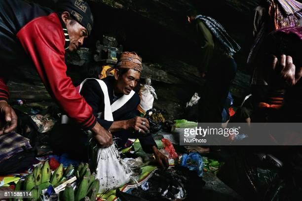 Tenggerese shaman praying for worshippers at Widodaren cave during the Tenggerese Hindu Yadnya Kasada festival in Probolinggo East Java Indonesia on...